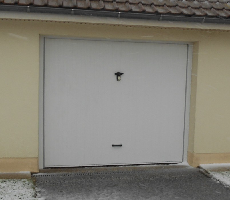 Porte de garage basculante boulogne sur mer fermetures for Alarme porte de garage basculante